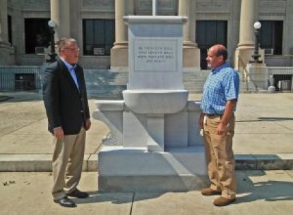 (Left to right) Johnston County Manager Rick Hester and Facilities Superintendent Daniel Clifton examine the new World War I monument recently replaced outside the old section of Johnston County Courthouse. The original monument was damaged beyond repair following a June 2015 construction accident. An exact replica made with stone from Montana was fabricated and installed recently. JoCoReport.com Photo