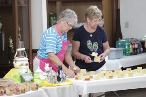 Tammy Adams (left) and Alma McLamb (right) prepare a back to school lunch for Meadow School teachers at Stone's Creek Advent Christian Church.