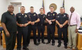The Four Oaks Men's Outreach thanks Four Oaks Police with a $25 Cracker Barrel gift card for each officer. JoCoReport.com Photo