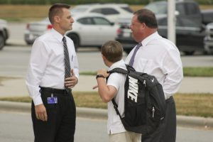 JCS Superintendent Dr. Ross Renfrow (right) drops off his son John Ross Renfrow (center) for his first day of school on Aug. 29. Welcoming them to the school is Archer Lodge Middle Principal Ben Williams (left).