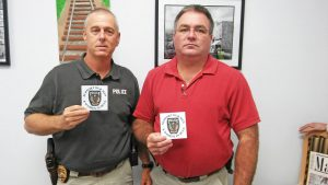 (Left to right) Selma Police Chief R.A. Cooper and Captain R.L. Daniels display a sticker created and donated by SRS Graphics to Selma police officers to show their support. A limited supply of the stickers are available to the public free of charge.  JoCoReport.com Photo