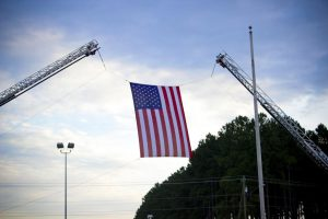 The Selma Fire Department ladder truck flies the American flag during the Smithfield-Selma September 11th commemoration ceremony.