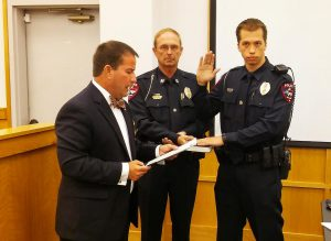 Office Kaleb Smith (far right) receives his oath from Smithfield Mayor Andy Moore (left) as Police Chief Keith Powell holds a Bible. JoCoReport.com Photo