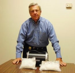 Sampson County Sheriff Jimmy Thornton shows 2.8 pounds of crystal methamphetamine seized inside an electronic device during a search warrant near Clinton on Wednesday.