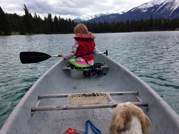 Girl and dog in Canoe The Fairmont Jasper Park Lodge
