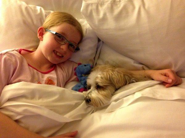 dog sleeping with girl