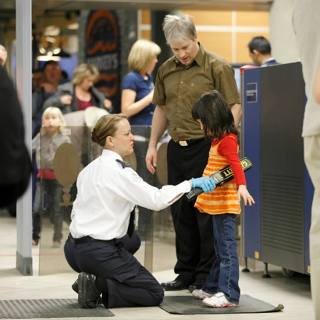 Family at airport security