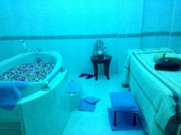 Spa room with bath
