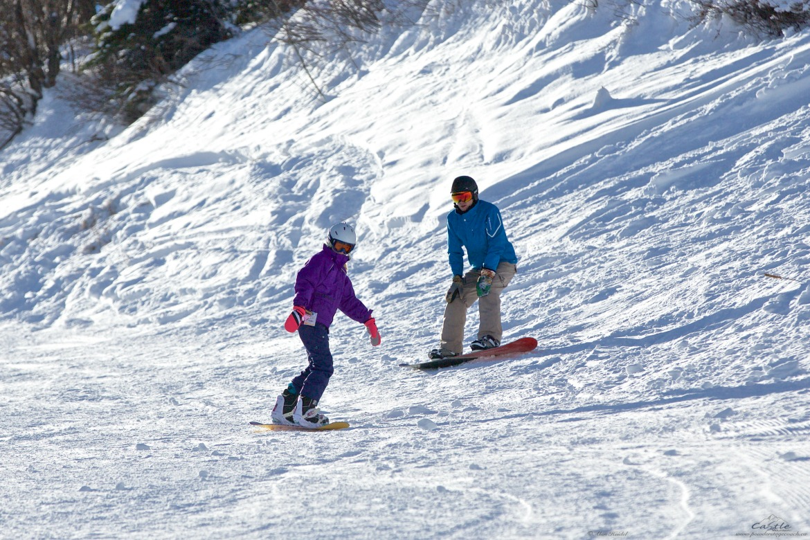 dad and daughter snowboarding