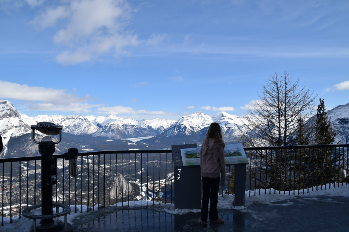 Girl looking at mountains from Banff Gondol