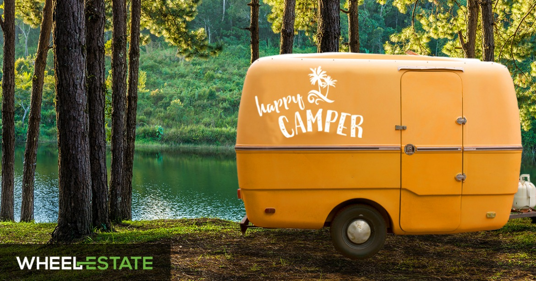 orange camper in the woods