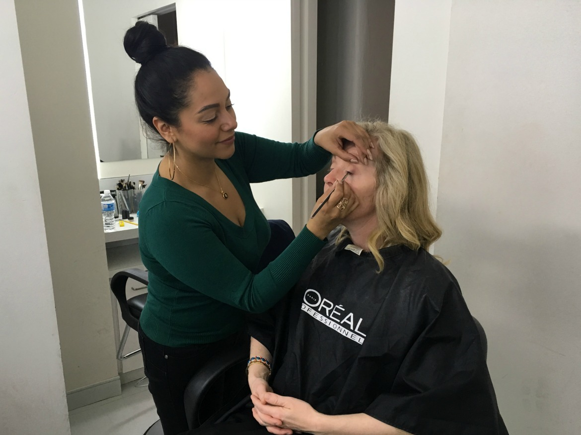 woman getting TV make up done
