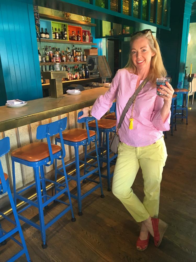 woman at tiki bar