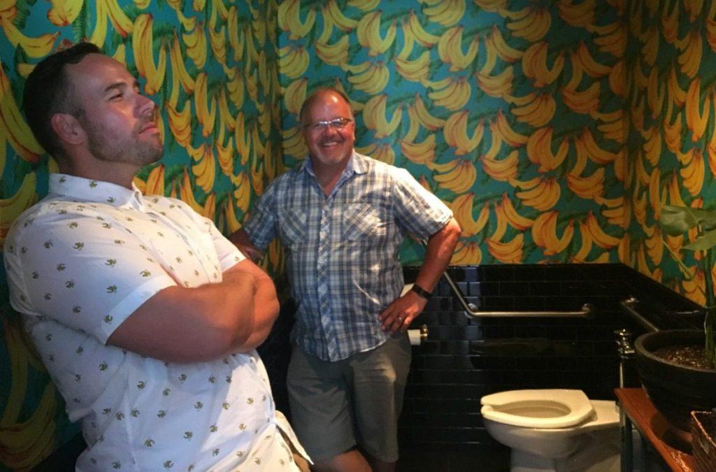 men hanging out in designer bathroom