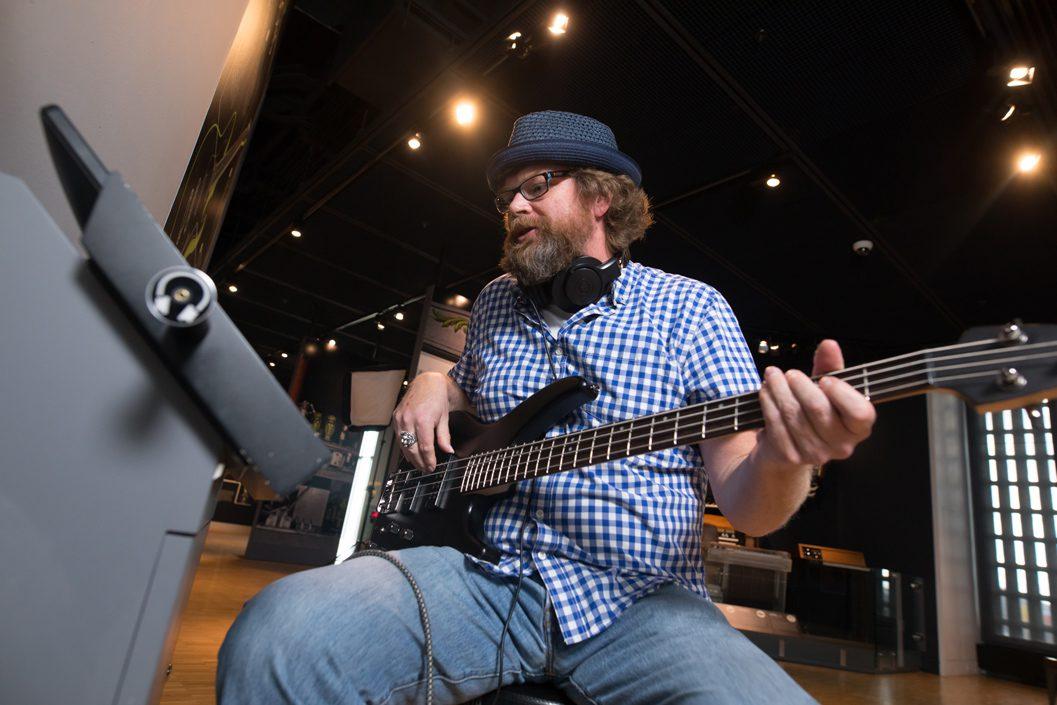 man playing guitar at museum