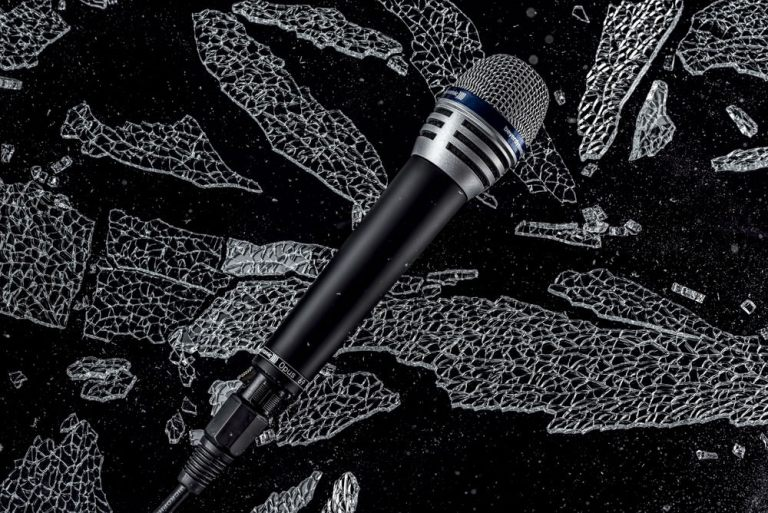 Glass shattering special effect advertising image of a microphone