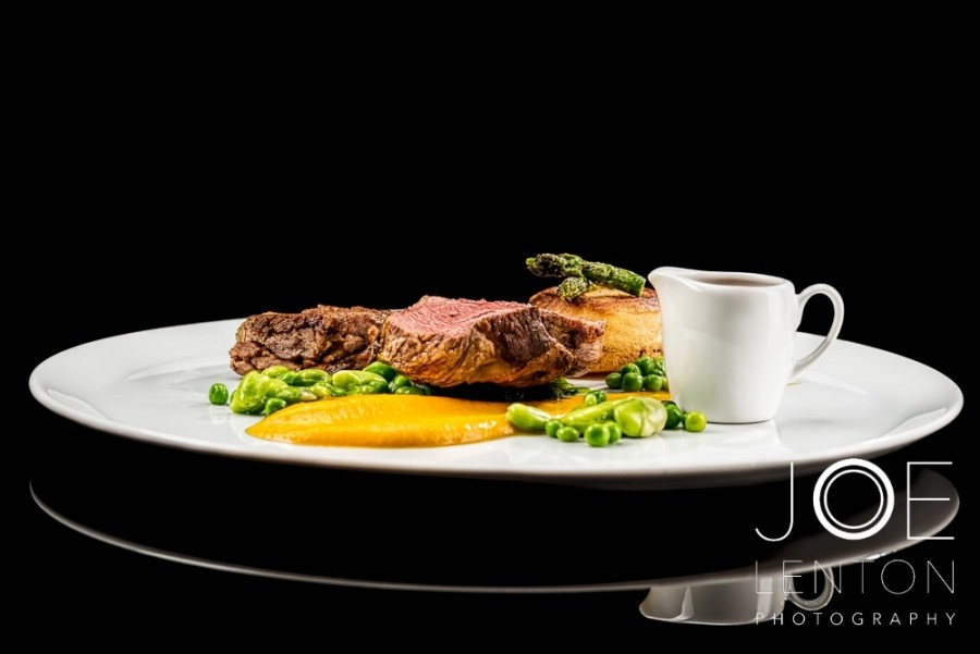 Food Photo Story - Duo of Lamb - plated with sauce in jug side view