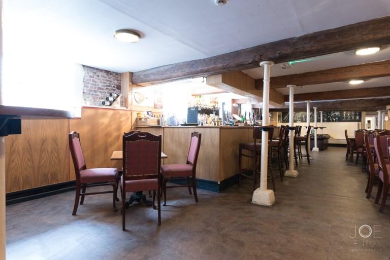 Rathskeller bar interior detail blue window - balancing light