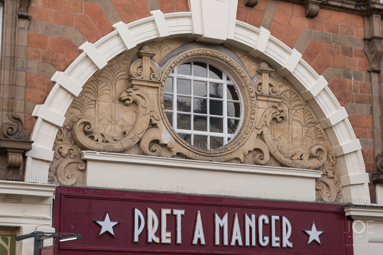 Architectural details above shop front