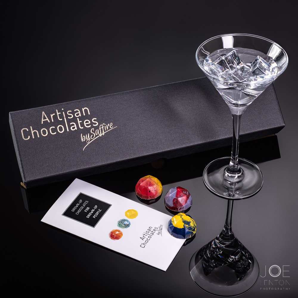 Box of luxury chocolates with drink in cocktail glass