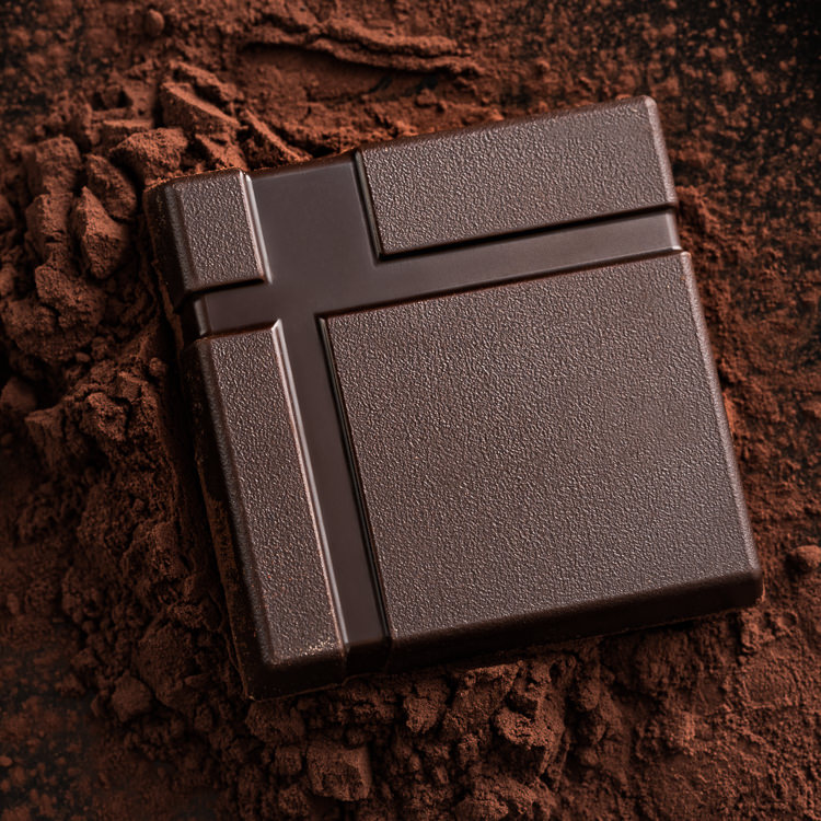 Creative Chocolate Photography - square dark chocolate on cocoa powder