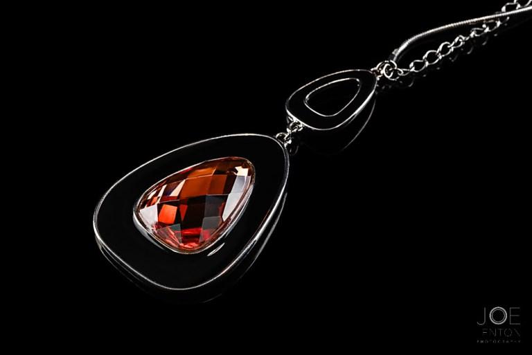 Jewellery photography of pendant on black background