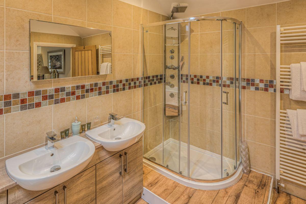 Shower & Sinks in Bathroom