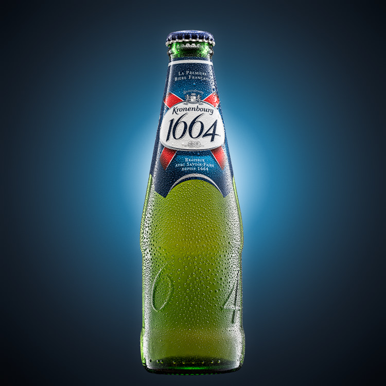 Kronenbourg Beer Bottle Advertising Photo on blue background glow
