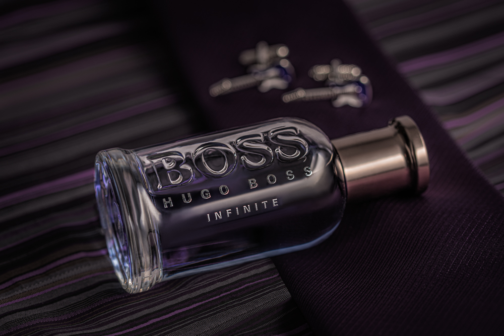 Still life photography of Boss Infinite with cufflinks, tie and shirt