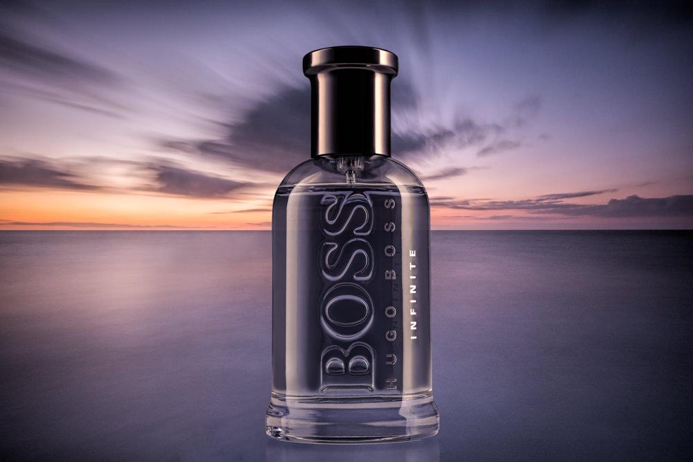 Hugo Boss Infinite with sunset seascape background