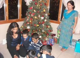 Kids opening up their gifts