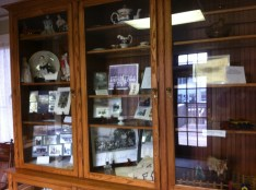 One of two large cabinets showcasing historical artifacts and memorabilia donated by families who grew up in Hightstown.