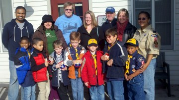 A picture of our cub scout pack, parents, and some of the Historical Society members outside of the museum.