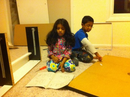 The kids helping me put together a desk
