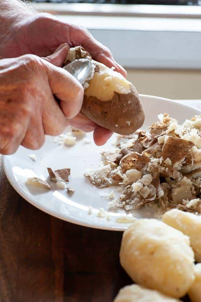 Peeling boiled potatoes.