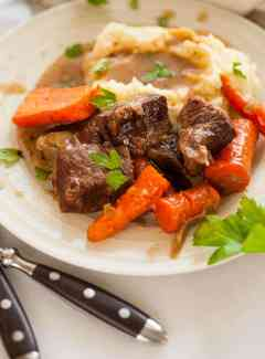 Braised short ribs slow cooked in Guinness stout until the meat is super tender and flavorful.   joeshealthymeals.com