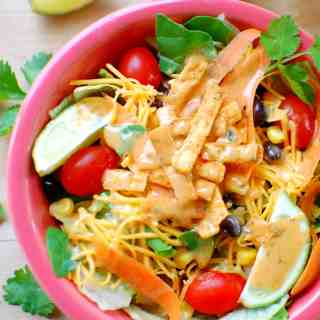 Southwest salad in a pink bowl.