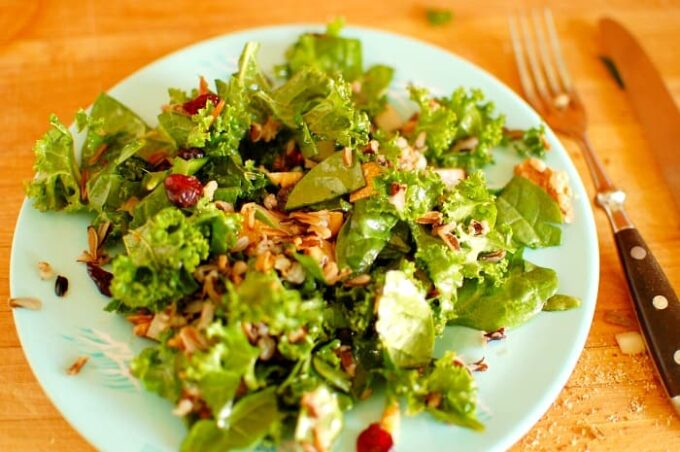 Kale and wild rice salad with pomegranate dressing. Hearty and healthy salad with a pomegranate molasses dressing. Mighty good tasting recipe. | joeshealthymeals.com