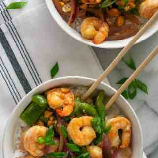 Overhead view of 2 bowls of shrimp stir fry.