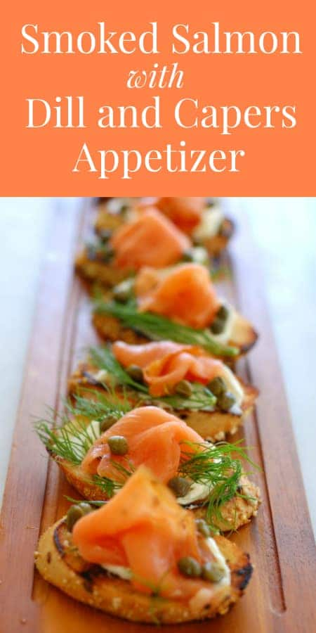smoked salmon, dill weed, capers, and cream cheese on a toasted bread appetizer