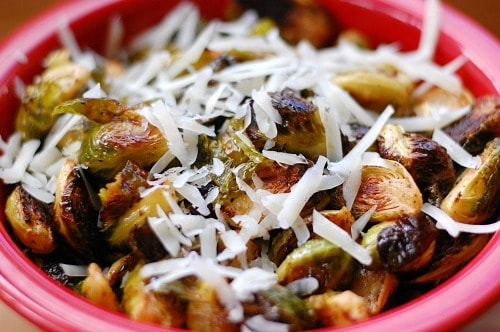 Roasted Brussels sprouts. These roasted Brussels sprouts get finished with some spicy hot sauce and a sprinkle of cheese. | joeshealthymeals.com