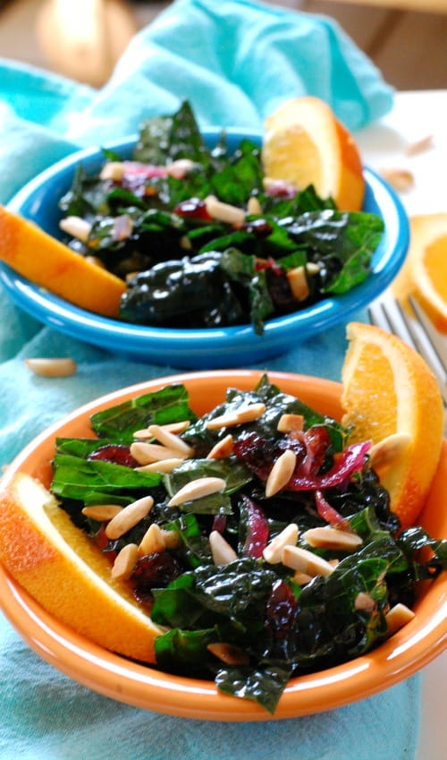 Kale Salad with Cranberry Orange Dressing. This kale salad is super yummy. Cranberries, garlic and red onions get sauteed to soften, then the orange juice, vinegar, orange zest, and honey are added.  Toss with the chopped bite sized kale and serve warm or at room temperature. | joeshealthymeals.com