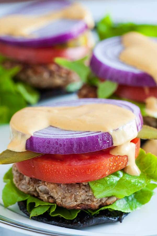 Nutty oat burger on portobello cap. Hearty, satisfying vegetarian burger. Have it by itself or on a bun with this special sauce. | joeshealthymeals.com