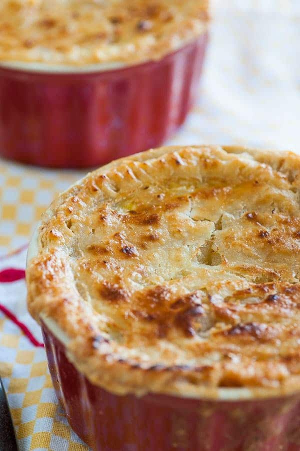 Individual ramekins of chicken pot pies. Delicious comfort food for a satisfying meal. | joeshealthymeals.com