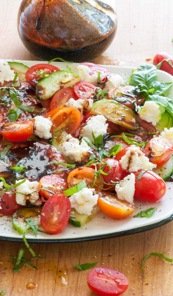 Reduced balsamic caprese salad. Next time you make a caprese salad, reduce the balsamic vinegar to boost the flavor and add in some cucumber. | joeshealthymeals.com