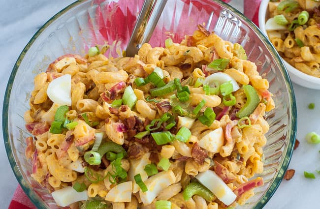 Macaroni deviled egg salad in a bowl. Delicious salad that everyone will love. Its deviled eggs in a bowl.   joeshealthymeals.com