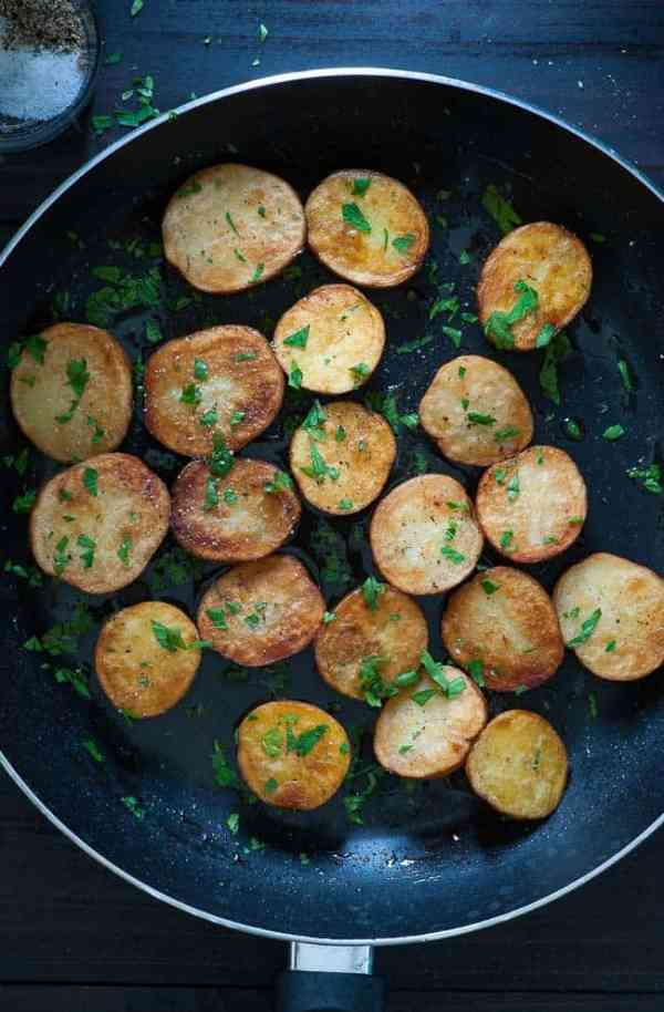 Pan braised baby potatoes, rosemary and garlic. Less than 30 minutes for a pan braised potato side dish. Easy and yummy. | joeshealthymeals.com