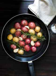Braised baby potatoes with rosemary and garlic. Less than 30 minutes for a pan braised potato side dish. Easy and yummy. | joeshealthymeals.com