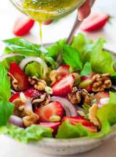 Fresh greens salad with basil mint vinaigrette. Tasty combination of flavors for a healthy salad.   joeshealthymeals.com
