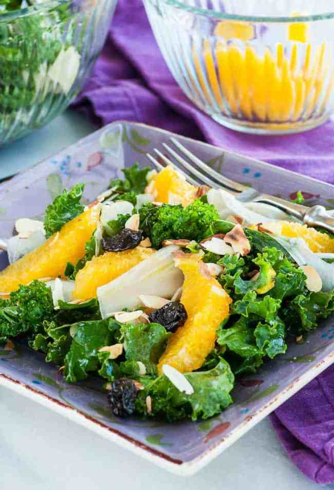 Kale and fennel salad with orange sections, dried cherries, and slivered almonds. Tossed with an orange and balsamic vinegar dressing. | joeshealthymeals.com